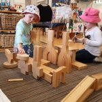 Kids playing with wooden blocks at preschool